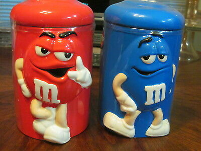 "RED~BLUE~LOT (2) M&M CANDY CONTAINER~COOKIE JARS~7"" X 4 1/4""~NEW SEALED (ds1352)"
