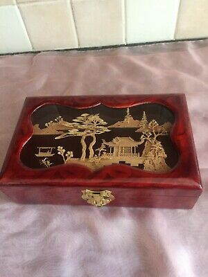 Lacquered Wooden box with an oriental cork design