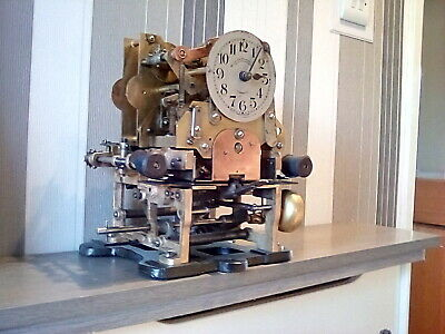 Antique clocking in machine  British time recorder clock movement