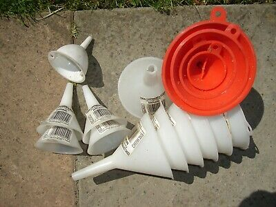 Set of 16 assorted size straight spout plastic funnels.