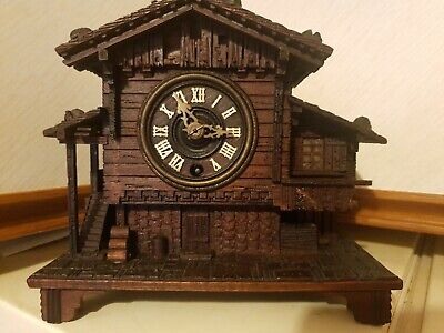 Carved Swiss Black Forest Chalet Clock