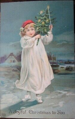 YOUNG GIRL IN WHITE ROBE & RED HAT HOLDING CHRISTMAS TREE 1908 Germany