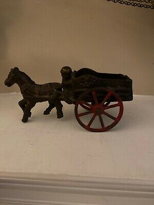 Antique cast iron small 6 inch horse drawn coal wagon and black driver