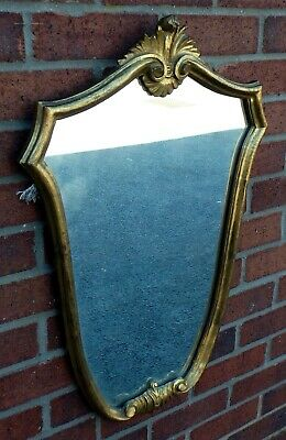 Edwardian antique Italian Rococo carved giltwood gold shield shaped wall mirror