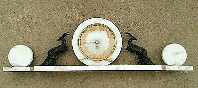 Vintage marble mantel clock with decorative Ibex and garniture roundels.