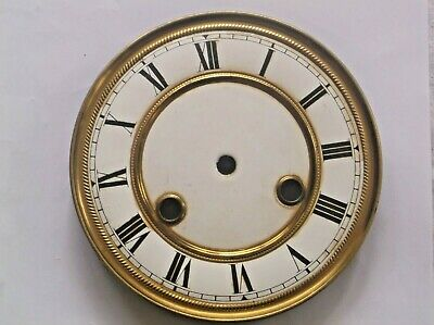 A Face From A Very Old  Wall Clock