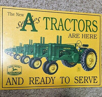 """Sign """"John Deere A Series Tractors are here and ready to serve"""""""