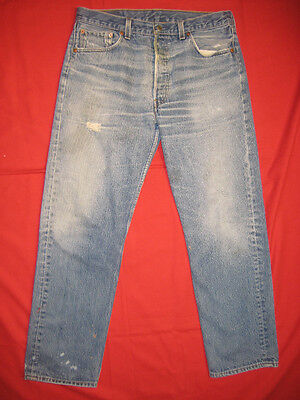D3035 frayed holes levi's 501 blue jeans 35x33 used destructed made in the USA