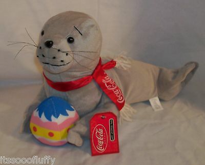 Coca-Cola Plush Laying Grey Seal w/Easter Egg & Scarf ~ w/Tags