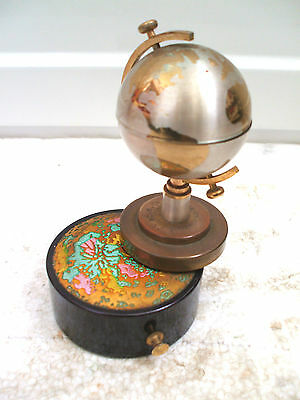 Collectable lighter inside a globe that rotates ontop of a music box by Windmill