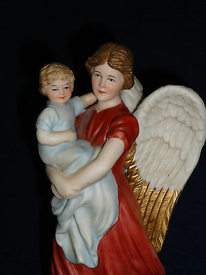 "8.25"" Homco GUARDIAN ANGEL holding Infant Child Figurine"