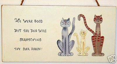 Funny WE were good Cat sign  Dog Scratching sofa again