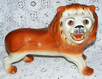 "Staffordshire   Large   Lion   With   Glass   Eyes   c1900   Ht. 10""  Length 14"""