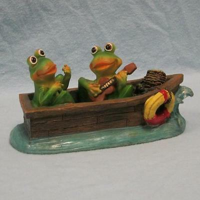 Frogs in Boat with Guitar Figurine