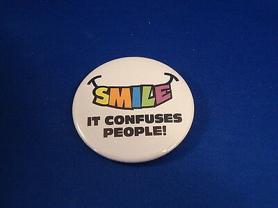 """SMILE IT CONFUSES PEOPLE"" BUTTON pin pinback 2 1/4"" badge NEW punk sarcasm BIG!"
