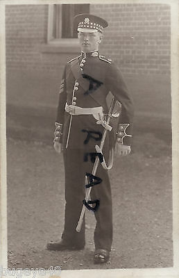 Soldier Colour Sergeant & Master Tailor Scots Guards in Full dress with sword