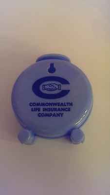"""Plastic Clock Bank """"Commonwealth Life Insurance Co."""" Blue, 3 1/2"""" Tall, 3"""" Wide"""
