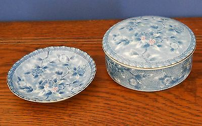 Circular porcelain box and dish decorated with a blue floral pattern