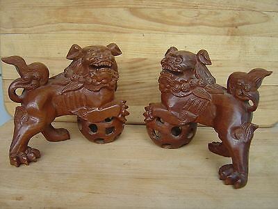 A MATCHING PAIR--- MALE @ FEMALE HAND CARVED WOODEN FOO DOGS
