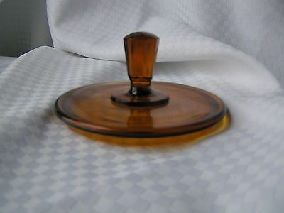 Amber glass lid with 8 sided knob two part mold pressed glass