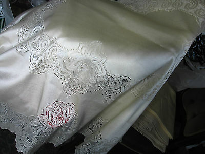 A pair of boxed, embroidered vintage pillowcases - details and photos to follow