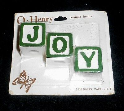 O Henry Ceramic Beads - package of 3 looks like white building blocks w/ J O Y