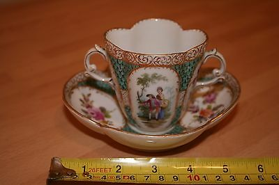 A 19TH CENTURY DRESDEN QUATREFOIL CUP AND SAUCER
