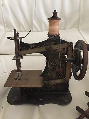 Antique Childs Sewing machine with table attachment