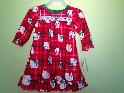 NWT.Size 12 months: Hello Kitty Pajama Dress. Polyester. Flame Resistant. Red.