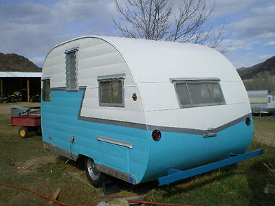 1957 shasta 15 ft  vintage travel trailer. great shape & solar equiped.