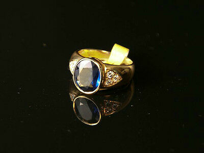 Lady's Oval Faceted Blue Sapphire & Round Brilliant Cut Diamond Ring (CBN305630)