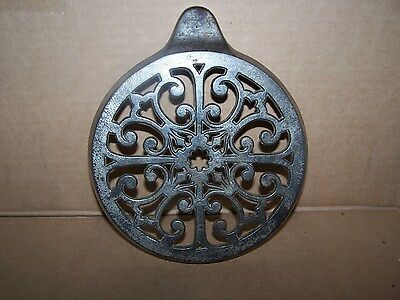 antique iron burner cover for woodstove