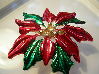 Gerrys Poinsettia Brooch with Red and Green Enamel and Gold Tone Center