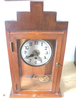 Stained Oak Glazed Case Enamelled Face Mantle Clock