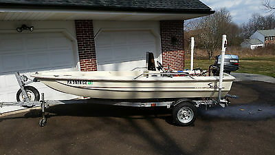 Scout 141 Sport with Yamaha 30 HP 2 Stroke and single axle trailer.