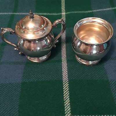Antique sugar and creamer set made in copper with silverplate over it.
