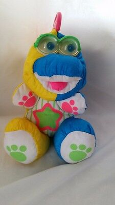 FISHER PRICE BABY PUFFALUMPS MULTICOLORED DINOSAUR PLUSH TAG EYES RATTLE 1991