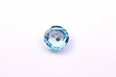 Blue Topaz Faceted Briolette Set With A White Topaz In A Gold Bezel