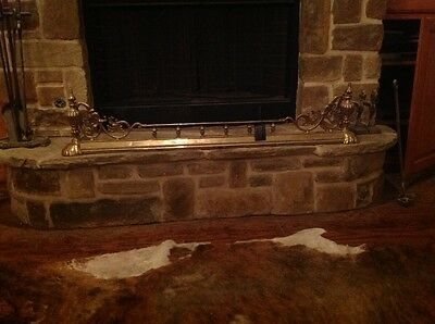 Antique brass fireplace fender with firedogs