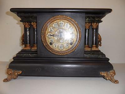 Vintage mantel clock in need of some restortion Black with brass fittings.