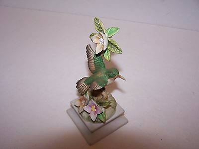"humming bird green /gray figurine, porcelain ,pink flowers 6 1/ 2 "" tall"