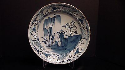 A Large Delft Charger With A Chinese Motif