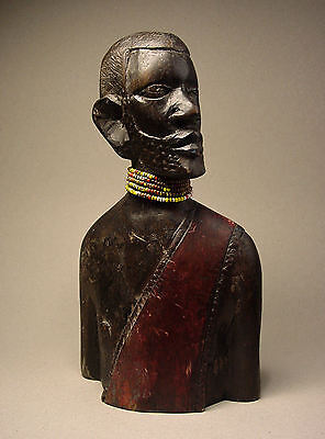 ANTIQUE WOOD-CARVED AFRICAN TRIBAL ELDER. Circa: 1900's