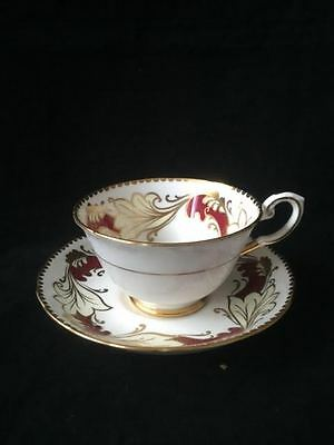Tuscan Tea Cup And Saucer. Burgundy And Cream Leaves Framed With Gold