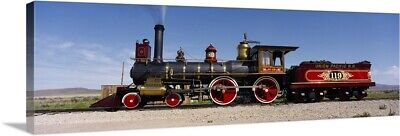 Premium Thick-Wrap Canvas Wall Art entitled Train engine on a railroad track,