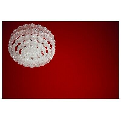 Poster Print Wall Art entitled A glass chandelier against a red ceiling