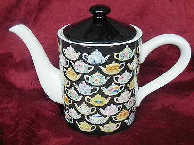 Department 56 Tea Leaves Porcelain Teapot with Teapot Graphics - Holds 5 Cups