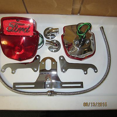 Ford 1953-60 F-100 all stainless tail light kit with Ford script 9 piece, new.