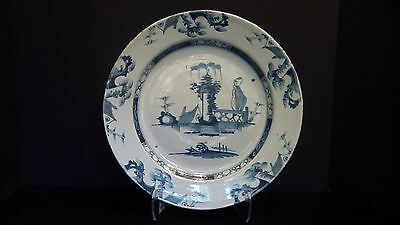 A Large Delft Charger With Chinoiserie Decorations