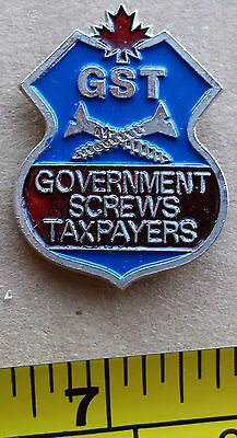 GST, GOVERNMENT SCREWS TAXPAYERS - Metal Lapel Pin, Red Maple Leaf